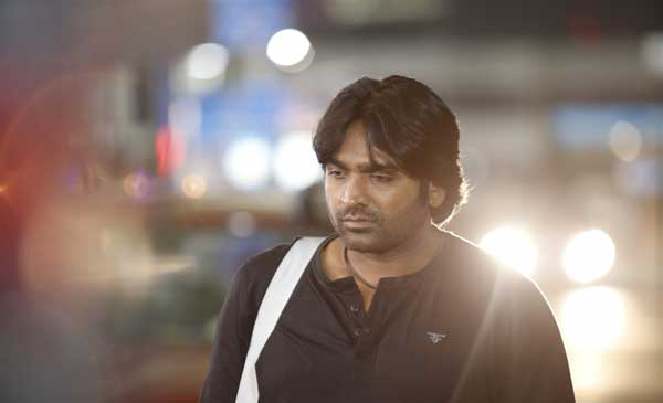 Vijay Sethupathi as K. Ramachandran (Ram)