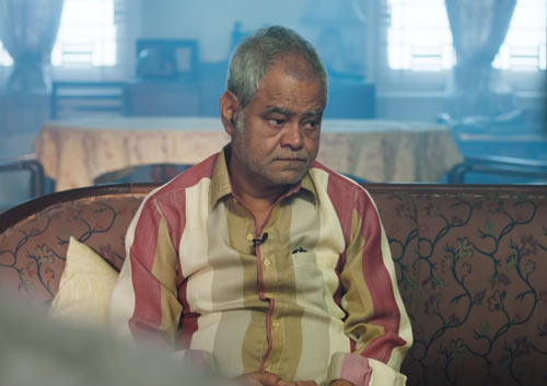 Sanjay Mishra as Sudheer